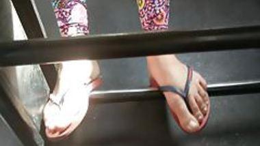 Teen girl feet on public bus