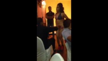 Shoving money in chaddi of the girl dancing mujra